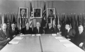 Ford was the last surviving member of the Warren Commission, appointed to investigate the assassination of President John F. Kennedy. Ford is at far left; Chief Justice Earl Warren, head of the panel, is seated at center. obitfile